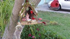 handmade fairy birdhouse...made from twigs, shells, popsicle sticks.