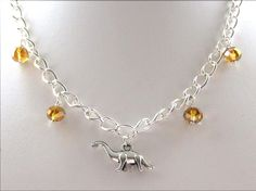 silver coloured dinosaur necklace with glass beads from F'Moush