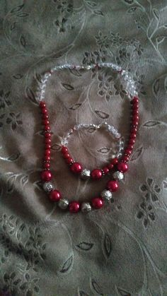 Deep red beaded necklace with matching bracelet