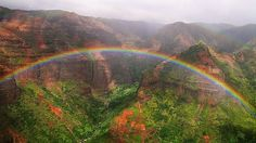 """Mt. Waialeale on Kauai, near Waimea Canyon has long been considered """"the wettest spot on earth."""" That just means it gets the best rainbows!"""