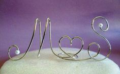 Cake Toppers Monogram Silver Set Individual Stands. $22.99, via Etsy.