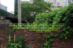 brick walled filled in with tape. by Aakash Nihalani.