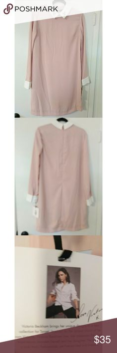 Victoria Beckham Pink Dress Bunny  Long Sleeve This pastel pink dress falls below the knee for a modest look.  It has white cuffs and the white collar has cute bunnies on it.  Zips up in back. Machine washable gentle. Victoria Beckham for Target Dresses Midi