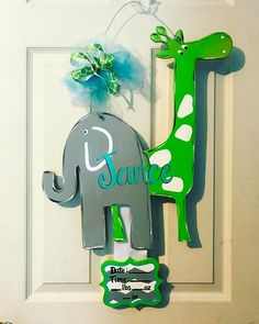 At the Zoo Baby Announcement Door Decor #handpainted #2017 #atthezoo #babyshower #babyboy #giraffeandelephant #stretchthegiraffe #ellietheelephant #atthezoobabydecor #jance #birthannouncement #hospitaldoorhanger #babyannouncement #shippingavailable #orderyourstoday #smithstreasuresonfb #evedeso #eventdesignsource - posted by Tammy Smith https://www.instagram.com/tlsmith81571. See more Baby Shower Designs at http://Evedeso.com