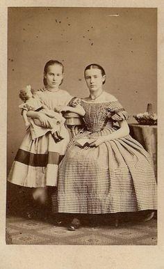 Older sister transitioning to longer skirts, but still wearing short sleeves and open neckline