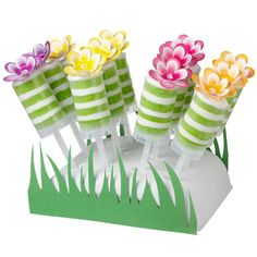 Enjoy a garden of treats at your next party! These pops make a pretty presentation dressed up as flowers in the grass-surrounded stand! (via Wilton.com)