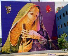 Graffitti - 5 de julio de 2014 - Edificio en frente a la Estación de Tren Urbano Sagrado Corazón, San Juan, Puerto Rico