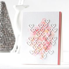 handmade love card ... watercolor wash topped with white die cut grid of little open hearts ... delightful card!