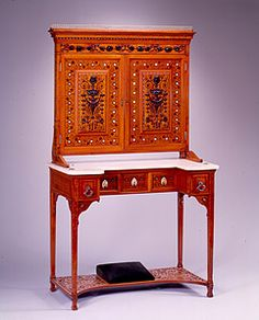 Artist Name: Unknown Artist (attr. to either George Shastey or Pottier and Stymus)  Title: Dressing Table  Date: ca.1880  Medium: Maple, mahogany, white pine, marble with marquetry of mahogany and mother-of-pearl, brass, mirrored glass, silver-plated drawer pulls, upholstered footrest  Dimensions: 86 3/8 x 36 x 18 3/4 inches  Credit Line: Virginia Carroll Crawford Collection  Accession Number: 1982.315