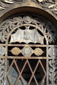 Bat detail on a crypt door, Pere Lachaise Cemetery, Paris, France. Perhaps if vampires were real, many would call this cemetery home.