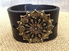 www.etsy.com/shop/journeyondesigns Leather cuff bracelet, handmade from recycled belts, hand-tooled, gold-toned embellishment, black leather