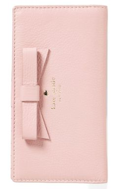 A prim bow and gilt logo lend Kate's Spade's signature style to this gorgeous pink wallet.
