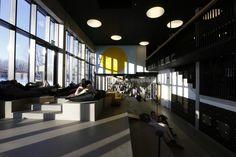 Viljandi State High School / Salto AB, atrium, hallway lockers, round lighting, lounge area, shared learning area, soft seating