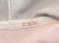 How to do a teensy monogram on a baby garment. Trudy Horne