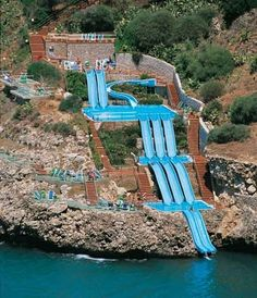 the citta del mare hotel in sicily has a SLIDE that goes in to the MEDITERRANEAN. ummm, yes, please.