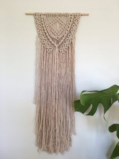 This Layered Cotton Macrame Wall Hanging is the epitome of Boho style. I have used a number of layers to build up texture and interest in this piece which I thoroughly enjoyed making and hopefully this comes across in my work. The unbleached cotton has a nice creamy colour to it. The overall size is 34 cms wide by 72 cms long (13.4 x 28) and the main section of macrame is 25 cms wide (9.8). Please feel free to take a look at my other items https://www.etsy.com/uk/shop/...