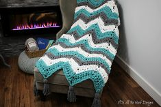 This is a PDF crochet pattern for a Super Bulky Chevron Blanket.