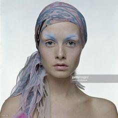 English model Twiggy wearing a patterned headscarf and eye shadow in matching pastel shades, early 1970s.