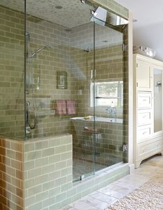 A floor-to-ceiling shower enclosure and a hidden steam generator create a luxurious at-home steam room. Here, a transom window helps circulate air when only the shower is being used. #walkinshower #walkinshowerideas #bathroommakeover #showerideas #bhg Steam Room Shower, Shower Alcove, Shower Floor Tile, Shower Base, Walk In Shower Designs, Master Shower, Glass Shower Doors, Shower Enclosure, Shower Remodel