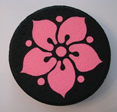"""Painted rock:  Acrylics on 11 1/2 """" cement stepping stone  Design is a free sample from Dover Publications  Painted June 2010"""