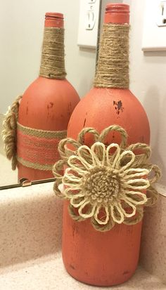 Large Wine Bottle Painted and Distressed. Embellished with Burlap Ribbon with Lace Overlay and a Burlap Flower in the middle and Burlap Twine at the Top. Can be customized and made to order according to your color and embellishment requests. Pictures are a few options available. Message me for questions and details.