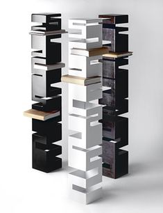 Designer Rick Ivey has shaped metal into contemporary bookcases featuring interesting shapes with a tower-like design. Each shelf has its own cubby-hole for book storage. - $750
