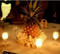 Yes! This is it! Pineapple centerpiece surrounded by white orchids
