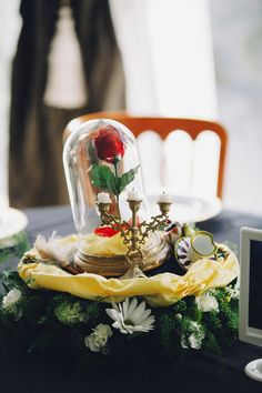 A Beauty & the Beast themed table centerpiece. Love this! Photo by Heather Elizabeth Photography