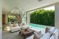 Sliding glass doors disappear within the walls completely removing all separation between the indoor and outdoor spaces.