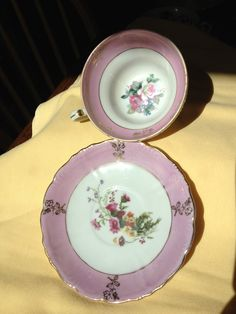 Pink Lusterware Three Footed Teacup and Saucer