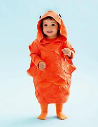 When we have kids, this will be one of their costumes!! Super cute goldfish made from orange sweatshirt and cupcake liners!