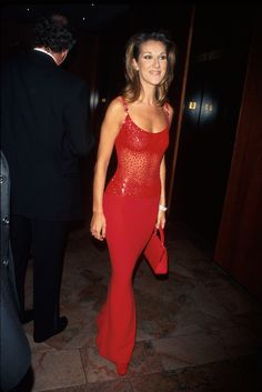1997 - We Can't Stop Thinking About These Outrageous And Chic Celine Dion Outfits - StyleBistro. Celine was a sight for sore eyes in this figure-hugging red dress that featured a sheer bodice. Celine Dion, Evening Dresses, Formal Dresses, Bold Fashion, High Fashion, Fringe Dress, Haute Couture Fashion, Lady In Red, Style Icons