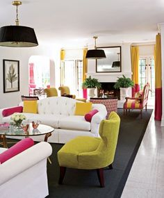 Oval Glass Top Table On Colorful Living Room Feat Wing Back Chair Also Black Area Rug And Modern Tufted Back Sofa