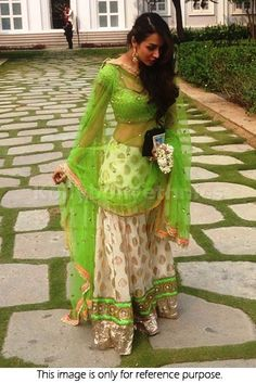 Bollywood Actress Malaika Arora Khan viscouse georgette lehenga in off white and parrot green color