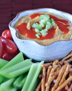 Tangy Spicy Buffalo Hummus - everyones favorite chickpea dip gets a spicy kick with everyones favorite hot sauce! @spabettie