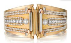 Phillips Auction April 2014: BOUCHERON A Gold Bracelet with Detachable Diamond and Cultured Pearl Clips,  circa 1935.