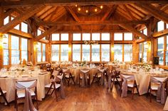 simple lodge wedding with neutral linens and suspended floral :: Brinton Studios