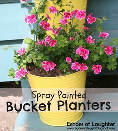 Spray Painted Bucket Planters ~ Add a dash of color to the front steps, inexpensive project!