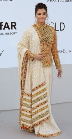 Aishwarya Rai Bachchan in a pretty sari. I think it can be made simply with a heavy gold border on a white embroidered sari. Indian Celebrities, Bollywood Celebrities, Bollywood Fashion, Indian Attire, Indian Wear, Patiala Salwar, Anarkali, Sharara, Indian Dresses