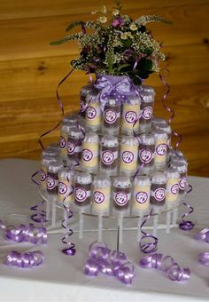 Cakeslider Creations Tier of push up cake pops.  Created for a birthday party.  Done in purple for the birthday girl how was turning seven years old named abby.