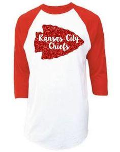 c973c5dd0 Kansas City Chiefs NFL Red Glitter Gold Glitter Arrow Raglan 3 4 Quarter  Sleeve T-Shirt. Kansas City Chiefs ShirtsKansas ...
