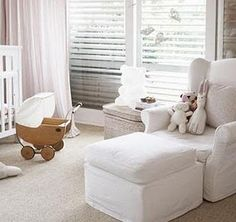 neutral + light colors, stuffed animals on chair, baby doll stroller