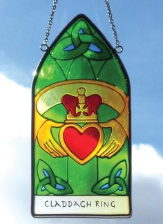 This Stained Glass window hanging depicts the Claddagh Ring. The Claddagh Ring, symbolising love, friendship and loyalty, was first used as a wedding ring over 400 years ago in the tiny fishing village 'The Claddagh' in Galway city, Ireland.
