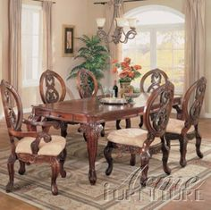 Versailles 7-Pc Dining Table Set by Acme by Acme Furniture. $1814.99. Versailles 7-Pc Dining Table Set by Acme The Versailles Collection is formal dining at its best with traditional old world detail and elaborate carvings perfect for any grand dining room. The collection provides a worldly charm that is meant to be eclectic, yet infused with practicality as well as style. The basic set includes a wide dining table combined with 4 carved back side chairs and 2 carve...