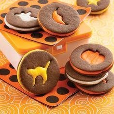 We used mini cookie cutters to create the Halloween shapes in these festive sandwich cookies.
