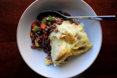 Shepards Pie  1 hr - - -   Serves 5-6    Based on recipe from Eat Like Me.    Ingredients:    4 cups mashed potatoes    garlic salt    1lb ground beef    1/3 cup onion, chopped    2 garlic cloves, minced    3 Tablespoons flour    1 Tablespoon tomato paste    1 Tablespoon Worcestershire sauce    1 Tablespoon soy sauce    1 can (14.5oz) chicken broth    2 cups frozen vegetable medley    salt & pepper