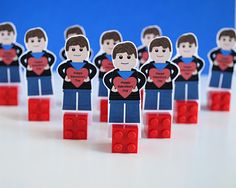 """zakka life: Lego Minifigure Valentines - there's no template here, but you could easily adapt the idea (use a photo of your child or create your own image) - """"To make the paper minifigures stand, they are wedged between two Lego blocks."""""""