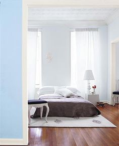 Stylish mattress on the floor. A good view and separation when looking in from another room.