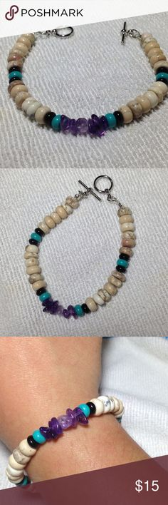 Howlite and Amethyst Bracelet This piece is made with white howlite and amethyst nuggets. Lovely natural turquoise and black agate beads serve as accents and add a pop of color. The bracelet is about 8 inches long total. PeaceFrog Jewelry Bracelets