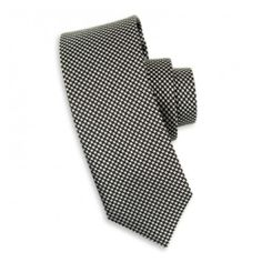 This black and white silk tie can be worn for any occasion and looks great with a black or white shirt.